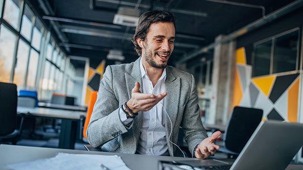 Man negotiating on laptop