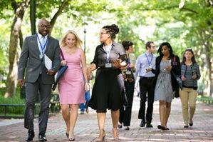 Executives walking on Penn's Locust Walk